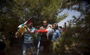Les Palestiniens ont procédé aux funérailles de l'enfant, vendredi 31 juillet.