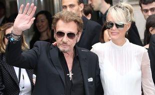 Johnny et Laetitia Hallyday à la Fashion week de Paris en juillet 2016.