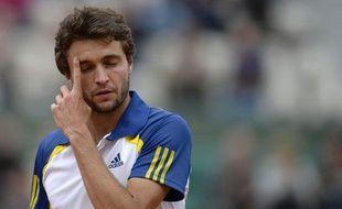 Le Français Gilles Simon lors de sa victoire contre Lleyton Hewitt au 1er tour de Roland-Garros, le 26 maiu2013.