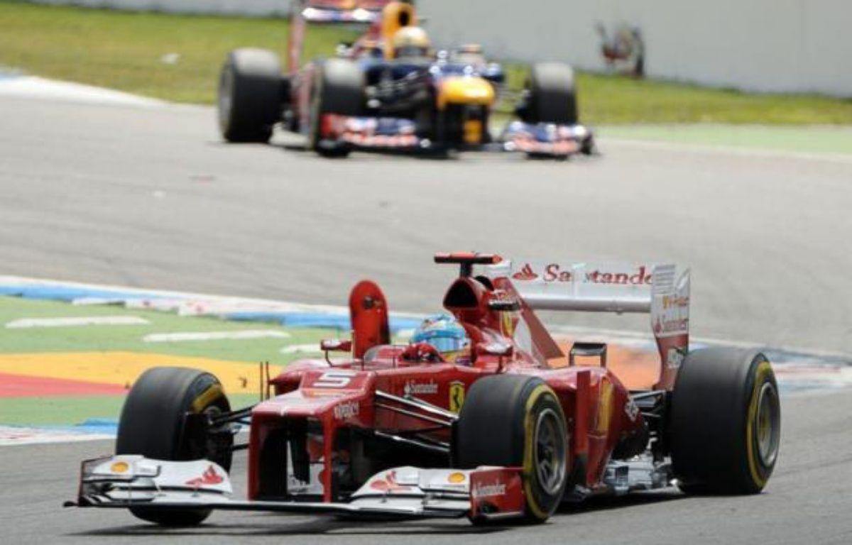 L'Espagnol Fernando Alonso (Ferrari) a remporté dimanche à Hockenheim le Grand Prix d'Allemagne de Formule 1, devant l'Allemand Sebastian Vettel (Red Bull) et le Britannique Jenson Button (McLaren), dépassé par Vettel dans l'avant-dernier tour – Tom Gandolfini afp.com