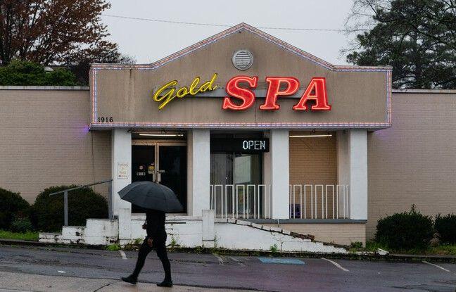 648x415 atlanta ga march 17 a man walks past a massage parlor where three women were shot and killed on