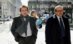 Bernard Tapie et son avocat  Hervé Temime à leur arrivée au pôle financier le 12 mars 2015 à Paris