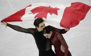 Tessa Virtue and Scott Moir of Canada celebrate during the venue ceremony after winning the ice dance, free dance figure skating final in the Gangneung Ice Arena at the 2018 Winter Olympics in Gangneung, South Korea, Tuesday, Feb. 20, 2018.