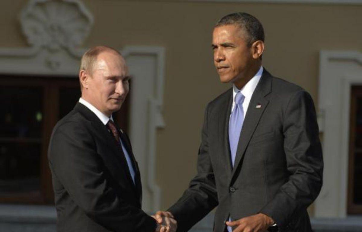 A la faveur du drame syrien, le président russe Vladimir Poutine a évincé cette année Barack Obama de la première place du classement Forbes des personnes les plus puissantes au monde, où le pape François fait son entrée à la quatrième place. – Eric Feferberg AFP