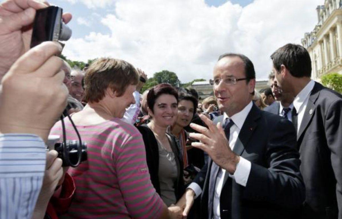La première interview télévisée du 14 juillet du président François Hollande a été regardée par 9,3 millions de téléspecteurs, ont annoncé dimanche TF1 et France 2 qui retransmettaient l'entretien. – Kenzo Tribouillard afp.com