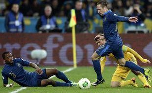 Patrice Evra et Franck Ribéry lors du match contre l'Ukraine le 15 novembre 2013.