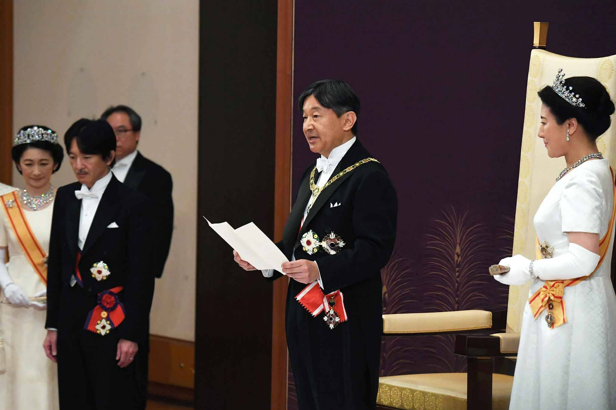 Japans new Emperor Naruhito (2nd R) delivers his speech as new Empress Masako (R), Crown Prince Akishino (2nd L) and his wife Crown Princess Kiko (L) attend a ceremony to receive the first audience after the accession to the throne at the Matsu-no-Ma state room inside the Imperial Palace in Tokyo on May 1, 2019. - Japan's new Emperor Naruhito formally ascended the Chrysanthemum Throne on May 1, a day after his father abdicated from the world's oldest monarchy and ushered in a new imperial era. (Photo by STR / Japan Pool / AFP) / Japan OUT / NO SALES - No Archives