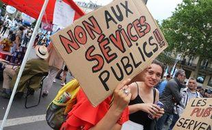 Une pancarte lors de la manifestation des fonctionnaires, le 22 mai 2018 à Paris.