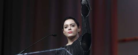 Actress Rose McGowan speaks at the inaugural Women's Convention in Detroit, Friday, Oct. 27, 2017. McGowan recently went public with her allegation that film company co-founder Harvey Weinstein raped her.