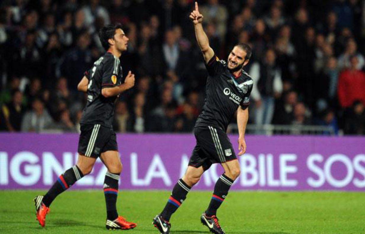 Le buteur lyonnais Lisandro Lopez lors du 1er match de Ligue Europa contre Prague, le 20 septembre 2012, à Gerland. –  PHILIPPE MERLE / AFP