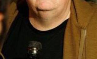 """Le cinéaste polémiste américain Michael Moore va faire une suite à son """"Farenheit 9/11"""", consacré à la """"guerre contre le terrorisme"""" de l'administration Bush après les attentats du 11 septembre 2001, film qui avait obtenu la Palme d'Or à Cannes en 2004, a annoncé la presse professionnelle."""