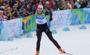 La biathlète Marie Dorin, à l'arrivée du sprint des Jeux de Vancouver, le 13 février 2010.