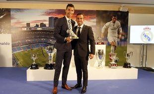 Cristiano Ronaldo, aidé par son agent Jorge Mendès (à droite), aurait dissimulé des millions au fisc espagnol.