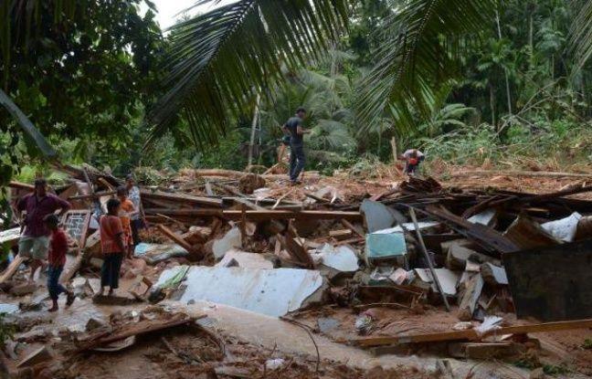 Mais où est Uccen ???  648x415_maison-detruite-pluies-mousson-coulees-boue-3-juin-2014-sud-colombo