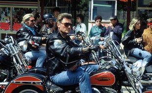 Johnny Hallyday lors du rassemblement de Harley Davidson a Paris. FRANCE - 14/05/1990