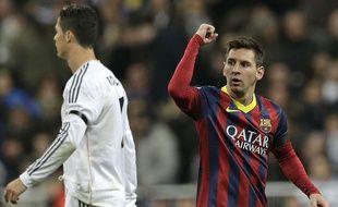 Lionel Messi et Cristiano Ronaldo lors d'un match de Liga, le 23 mars 2014 à Madrid.