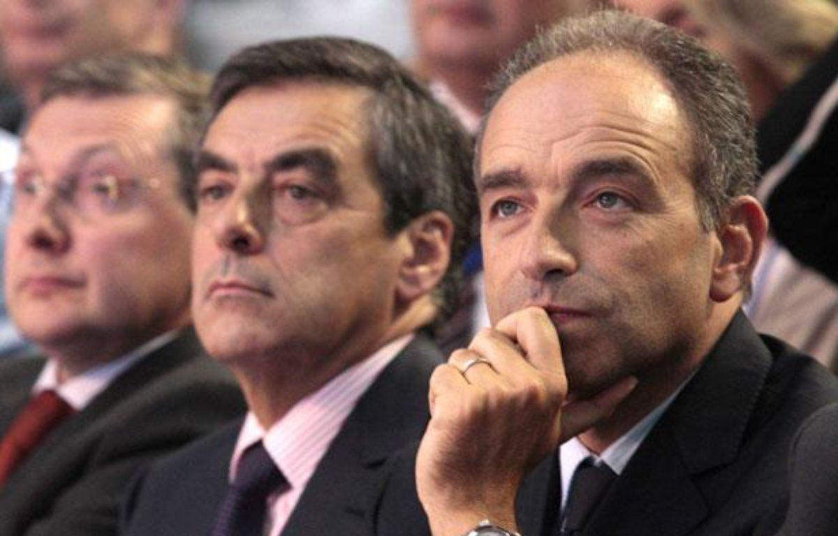 François Fillon (deuxième à gauche) et Jean-François Copé, lors des journées parlementaires de l'UMP à Marcq-en-Baroeul, le 27 septembre 2012. – B. CHIBANE/SIPA