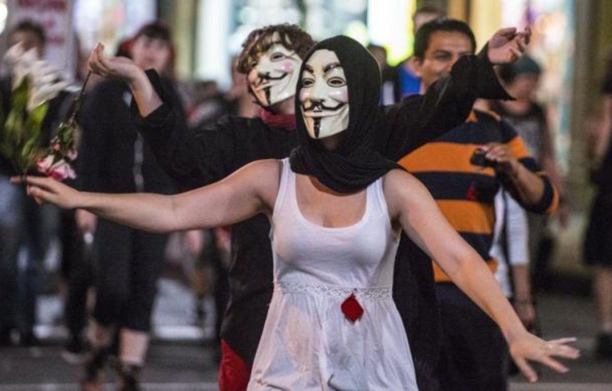 Le Grand Prix du Canada commence vendredi à Montréal dans un climat de tension: les étudiants grévistes veulent en profiter pour défendre leur cause, tandis que les pirates informatiques d'Anonymous et d'autres adversaires de la fête automobile annoncent des turbulences, dont une manifestation de personnes nues jeudi soir. – Rogerio Barbosa afp.com