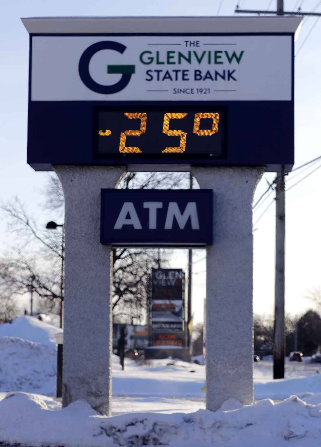 A sign shows the current outdoor temperature in Glenview, Ill., Wednesday, Jan. 30, 2019. A deadly arctic deep freeze enveloped the Midwest with record-breaking temperatures on Wednesday, triggering widespread closures of schools and businesses, and prompting the U.S. Postal Service to take the rare step of suspending mail delivery to a wide swath of the region.