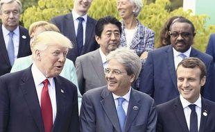 Le président américain Donald Trump, le Premier ministre italien Paolo Gentiloni et le président français Emmanuel Macron lors du sommet du G7 à Taormine, en Italie.