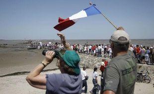 Des spectateurs lors du passage du Gois sur le Tour de France, le 2 juillet 2011