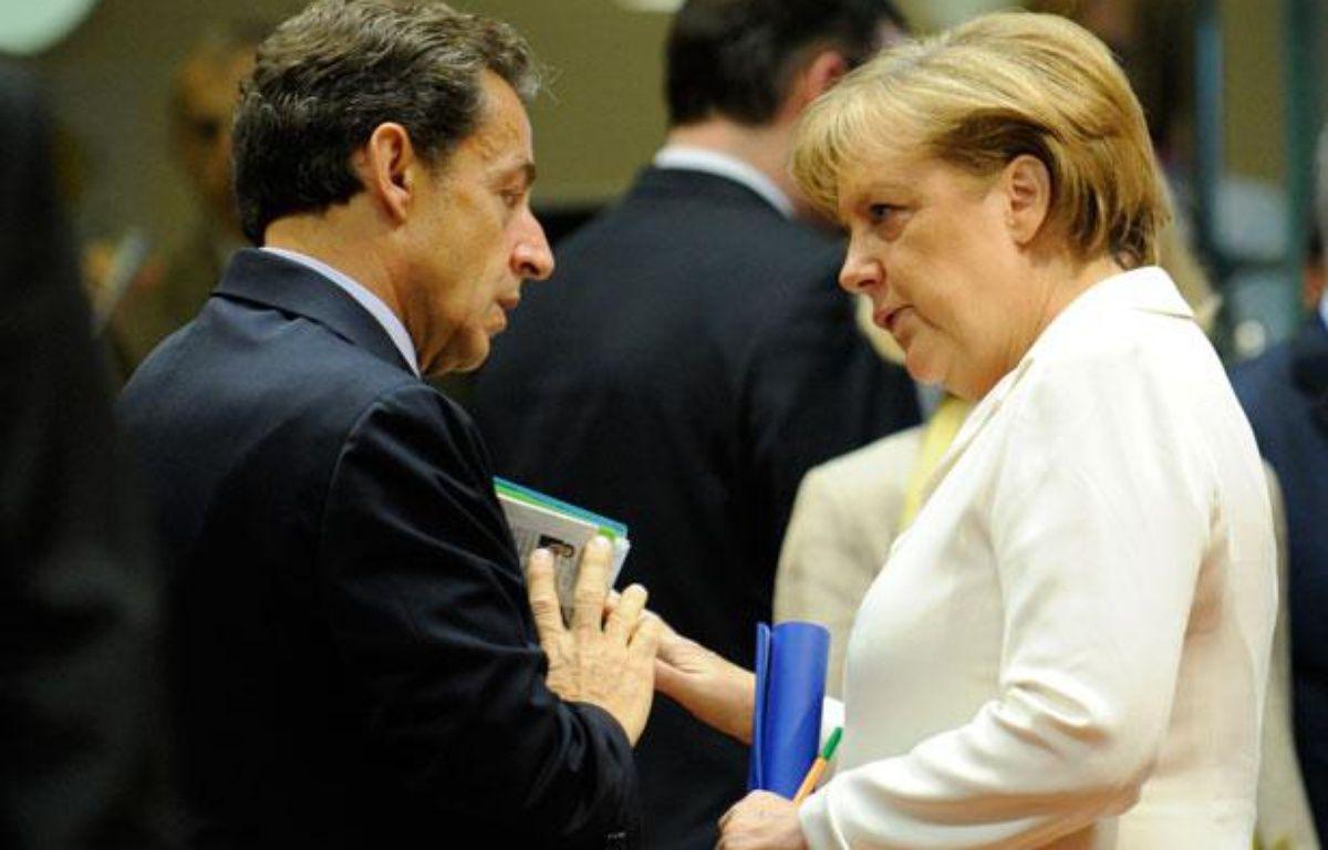 Nicolas Sarkozy et Angela Merkel en juin 2011 à Bruxelles. – J. THYS / AFP