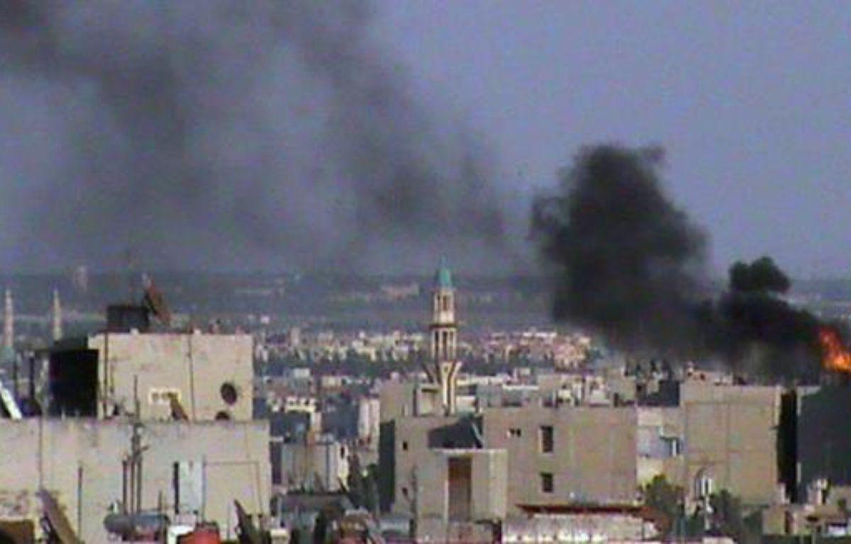 Des centaines de familles étaient piégées sous les bombardements samedi dans la ville de Homs, l'un des bastions de la rébellion en Syrie, où les violences incessantes ont déjà fait 18 morts samedi à travers le pays. –  afp.com