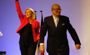 French far-right National Front party leader Marine Le Pen, left, waves to supporters with her father Jean-Marie Le Pen, France's far right National Front party honorary  president, during a meeting as part of the up coming European elections, in Marseille, southern France, Tuesday, May 20, 2014. The National Front, which also wants to unravel the European Union and withdraw France from the euro currency, hopes to win up to 20 of France's 74 European Parliament seats in the Sunday, May 25 vote. (AP Photo/Claude Paris)/MAR105/346987068080/1405202211