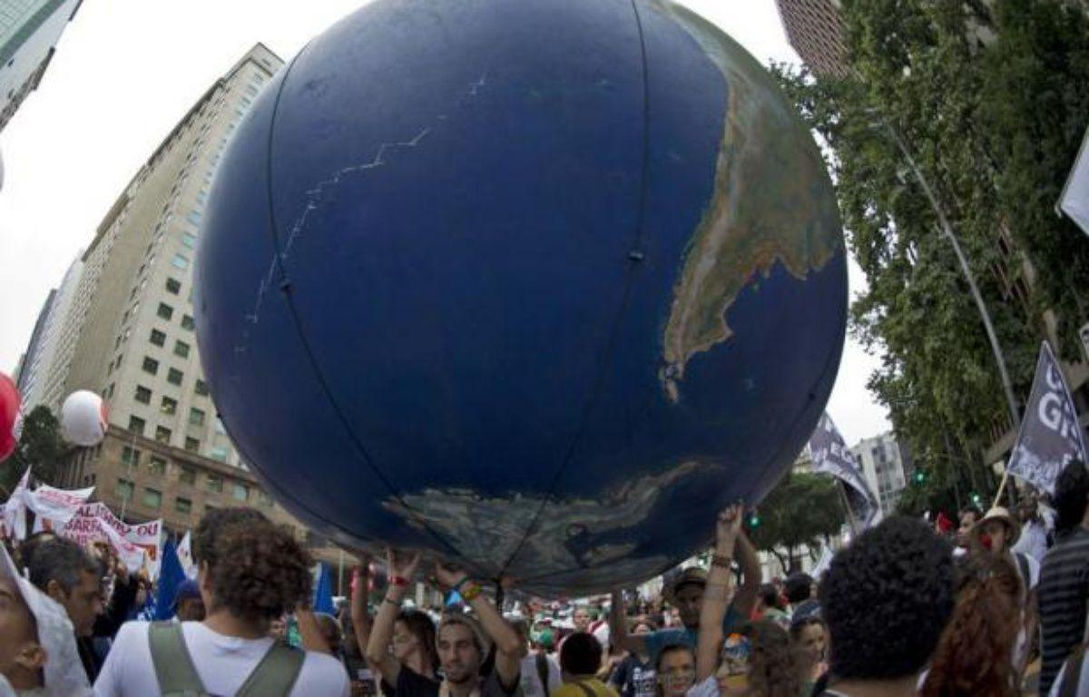 Le sommet Rio+20 sur le développement durable s'est ouvert mercredi à Rio de Janeiro par des appels urgents à l'action, afin de mettre la planète sur un chemin plus écologique et social. – Christophe Simon afp.com