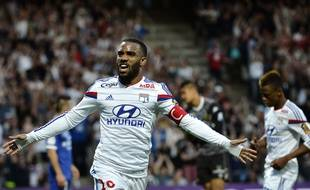 Lyon's French forward Alexandre Lacazette celebrates after scoring a goal during the French L1 football match Olympique Lyonnais (OL) vs SC Bastia (SCB) on April 15, 2015, at the Gerland Stadium in Lyon, central-eastern France. AFP PHOTO / JEFF PACHOUD