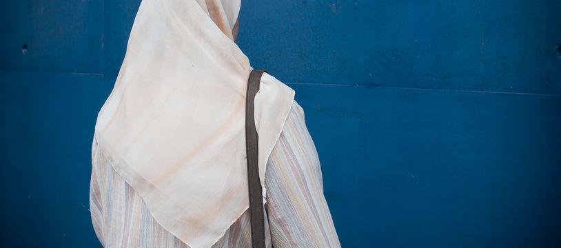 Une femme portant le voile. (Illustration)