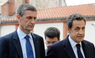 (FILES) A picture taken on March 21, 2012, in Toulouse, southwestern France, shows then France's President Nicolas Sarkozy (R) and General Director of National Police (DGPN) Frederic Pechenard arriving at the Perignon barraks to visit the two officers of the RAID police special forces unit injured today when the RAID tried to storm a self-declared Islamist gunman holed up his apartment in Toulouse, Mohamed Merah. Merah's killing spree claimed seven livesbefore been killed during the assault of his flat. Pechenard, UMP right-wing party member, will lead Sarkozy's campaign for the UMP presidency next november. Sarkozy, 59, announced his return on September 19, 2014 on Facebook after months of speculation, setting the scene for a battle among leading centre-right opposition figures for the 2017 general election end-game as they try and put behind in-fighting and scandals that have torn the UMP party apart.  AFP PHOTO /JEAN-PIERRE MULLER