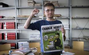 """Une plainte a été déposée au parquet de Paris contre Charlie Hebdo pour """"provocation à la haine"""" après la publication mercredi par l'hebdomadaire satirique de caricatures du prophète Mahomet, a-t-on appris de source judiciaire."""