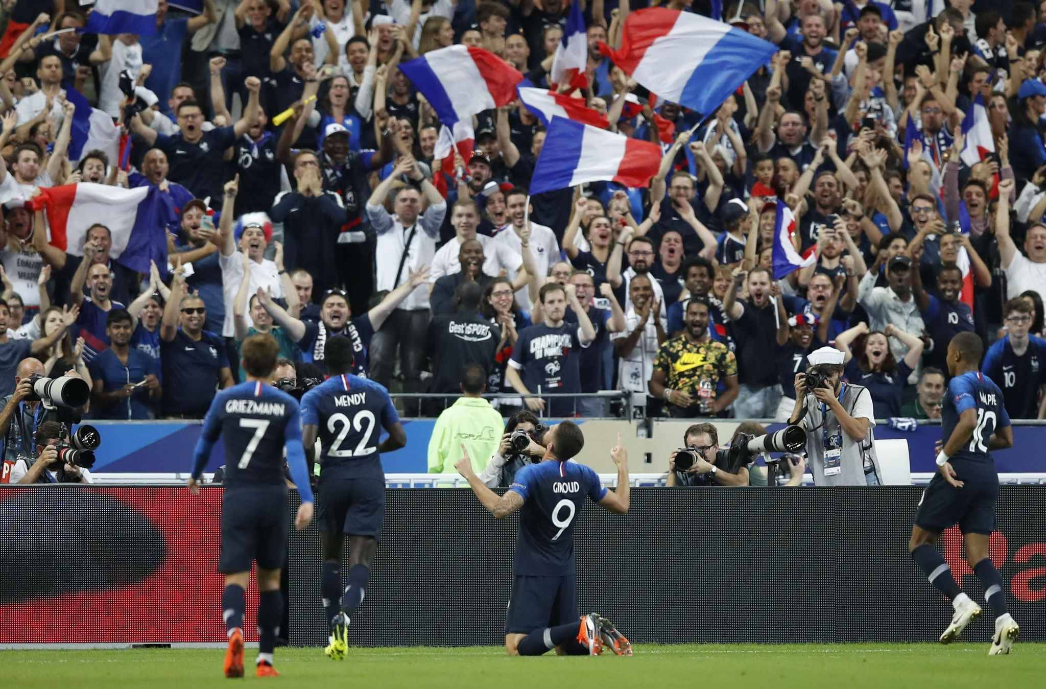France players celebrate after France's Olivier Giroud, centre, scored his side's second goal during the UEFA Nations League soccer match between France and The Netherlands at the Stade de France stadium in Saint-Denis, outside Paris, France, Sunday, Sept. 9, 2018.