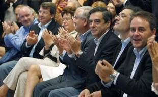France's Prime Minister Francois Fillon (3rd R) applauds with members of his government during the summer meeting of their UMP political Party in Royan, Southwestern France, September 7, 2008. REUTERS/Regis Duvignau (FRANCE)
