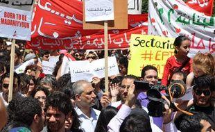 Les slogans étaient nombreux dans la manifestation, comme ici à gauche avec«Né pour être citoyen».