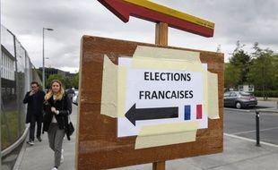 Un panneau indique un bureau de vote en Suisse.