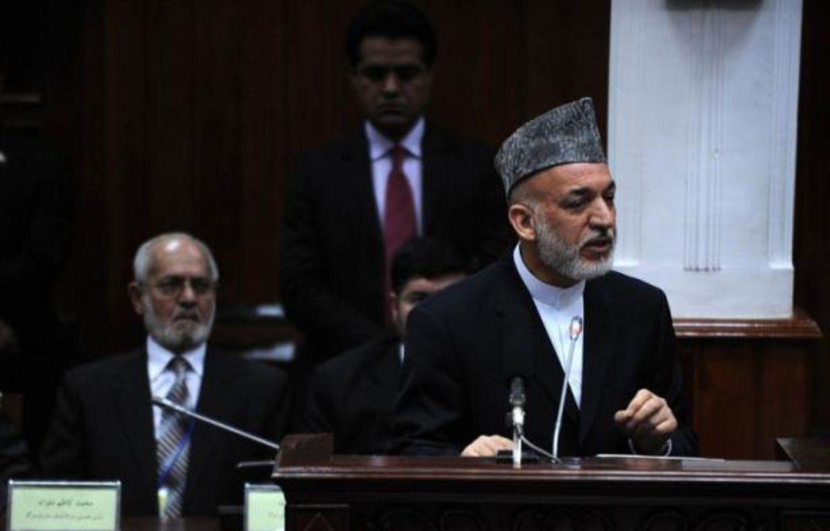 Le président afghan Hamid Karzaï a présenté jeudi devant le Parlement une image désenchantée de son pays après plus de dix ans de présence occidentale, s'alarmant notamment de la hausse du nombre d'attaques contre ses forces de sécurité, censées protéger seules le pays après 2014. – Qais Usyan afp.com