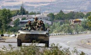 """""""Le retrait complet dépend de la politique de Saakachvili et de l'action de ses forces"""", a ajouté le représentant permanent russe à l'Otan. """"Nous voulons terminer ce cauchemar le plus tôt possible""""."""