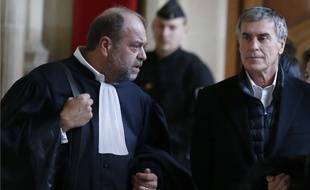 Jerôme Cahuzac et son avocat Eric Dupond-Moretti, 12 février 2018. AP Photo/Michel Euler
