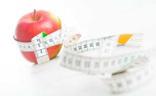 Illustration d'une pomme et d'un mètre ruban.