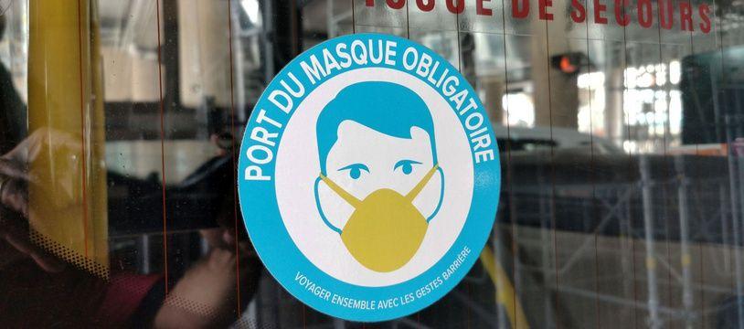 Illustration d'un message de port du masque obligatoire. Ici à Bourgoin.