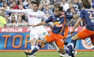 Pour André Ayew, Garry Bocaly (au c.) est devenu « un des piliers de Montpellier».