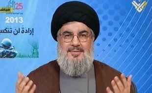 """Le chef du mouvement chiite libanais Hezbollah Hassan Nasrallah a promis samedi à ses partisans la victoire dans la guerre en Syrie où son mouvement est engagé aux côtés de l'armée gouvernementale contre les rebelles. +++ RESTRICTED TO EDITORIAL USE - MANDATORY CREDIT """"AFP PHOTO / HO / AL-MANAR"""" - NO MARKETING NO ADVERTISING CAMPAIGNS - DISTRIBUTED AS A SERVICE TO CLIENTS +++"""