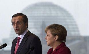 """La chancelière Angela Merkel a manifesté dimanche au Premier ministre grec Antonis Samaras """"son soutien"""" pour les réformes engagées et l'a incité à continuer, selon un communiqué du gouvernement allemand."""