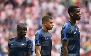 Paul Pogba, Kylian Mbappé, N'Golo Kanté le 15 juillet 2018 lors de la finale du Mondial.AFP PHOTO / Jewel SAMAD