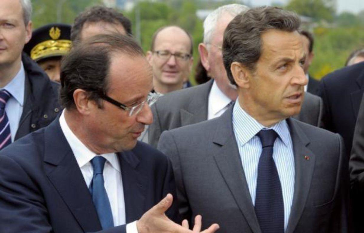 """Nicolas Sarkozy, candidat à sa succession à l'Elysée, a dénoncé """"la démagogie extravagante"""" de son adversaire socialiste, François Hollande, quand il propose de créer 60.000 postes supplémentaires dans l'Education nationale, lundi sur RTL. – Philippe Wojazer afp.com"""