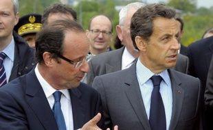"""Nicolas Sarkozy, candidat à sa succession à l'Elysée, a dénoncé """"la démagogie extravagante"""" de son adversaire socialiste, François Hollande, quand il propose de créer 60.000 postes supplémentaires dans l'Education nationale, lundi sur RTL."""