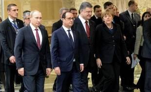 Le président russe Vladimir Poutine (gauche), le président François Hollande, le président ukrainien Petro Porochenko et la chancelière allemande Angela Merkel à Minsk le 11 février 2015