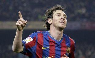 Lionel Messi célèbre son 100e but en match officiel sous les couleurs de Barcelone, le 16 janvier 2010 face à Séville.